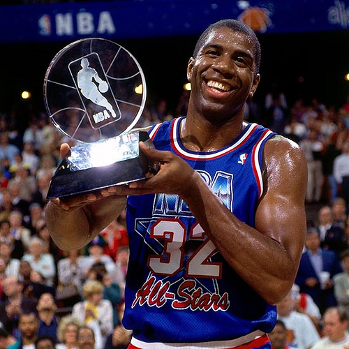 ORLANDO- FEBRUARY 9: Magic Johnson #32 of the Western Conference All-Stars holds the MVP trophy following the 1992 NBA All Star Game on February 9, 1992 at the Orlando Arena in Orlando, Florida. NOTE TO USER: User expressly acknowledges that, by downloading and or using this photograph, User is consenting to the terms and conditions of the Getty Images License agreement. Mandatory Copyright Notice: Copyright 1987 NBAE (Photo by Andrew D. Bernstein/NBAE via Getty Images)