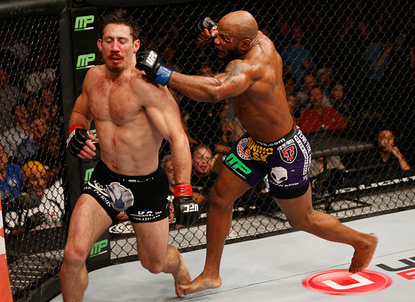 LAS VEGAS, NV - SEPTEMBER 27:  (R-L) Yoel Romero punches Tim Kennedy in their middleweight fight during the UFC 178 event inside the MGM Grand Garden Arena on September 27, 2014 in Las Vegas, Nevada.  (Photo by Josh Hedges/Zuffa LLC/Zuffa LLC via Getty Images)