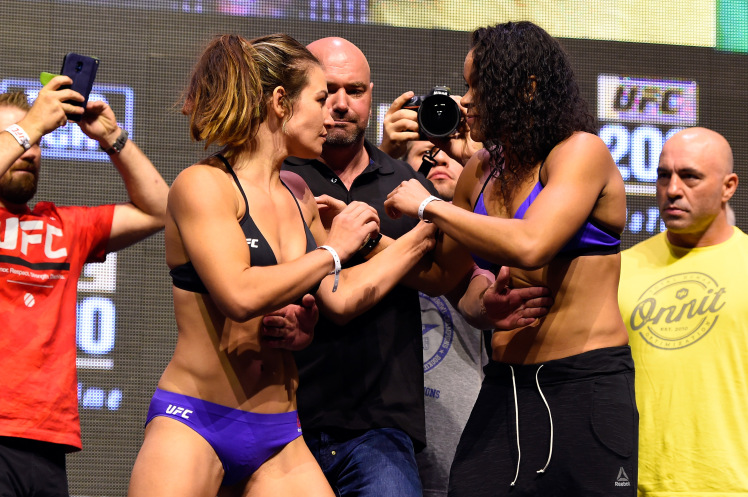 LAS VEGAS, NV - JULY 08:   (L-R) Opponents Miesha Tate and Amanda Nunes of Brazil face off during the UFC 200 weigh-in at T-Mobile Arena on July 8, 2016 in Las Vegas, Nevada. (Photo by Josh Hedges/Zuffa LLC/Zuffa LLC via Getty Images)