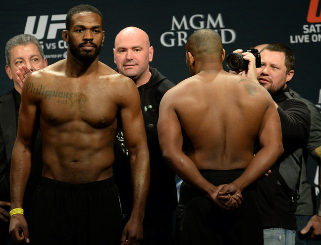 Jan 2, 2015; Las Vegas, NV, USA; UFC President Dana White separates Jon Jones and Daniel Cormier during the weigh in for their Light Heavyweight Title Bout at MGM Grand Garden Arena. Mandatory Credit: Jayne Kamin-Oncea-USA TODAY Sports