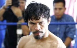 184659-congressman-and-boxer-manny-pacquiao-of-the-philippines-poses-during-a