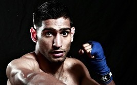 Amir Khan has broken his training schedule to return to the UK to spend a few weeks with his family