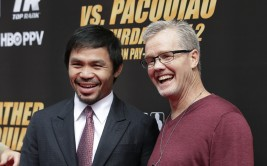 Boxer Manny Pacquiao, left, of the Philippines, and trainer Freddie Roach pause for photos as they arrive for a news conference, Wednesday, March 11, 2015, in Los Angeles. Pacquiao is scheduled to fight Floyd Mayweather Jr. in Las Vegas on May 2. (AP Photo/Jae C. Hong) ORG XMIT: CAJH101