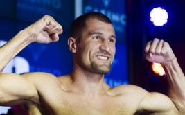 Light heavyweight champion Sergey Kovalev from Russia flexes during the weigh-in in Montreal, Friday, March 13, 2015, ahead of his title defence against Jean Pascal from Canada. THE CANADIAN PRESS/Graham Hughes