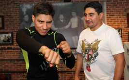 "June 24, 2015, Hollywood, Ca.    --  Undefeated WBA super lightweight world champion Jessie Vargas(L) and  trainer/legendary champion Erik Morales(R) work out during media dat at Fortunes Boxing Gym Wednesday for his upcoming title fight against former two-division world champion and highly-rated pound for pound fighter Timothy ""Desert Storm"" Bradley Jr. , Saturday, June 27, at StubHub Center in Carson, Calif.      Promoted by Top Rank®, in association with Tecate, this exciting event will be televised live on HBO World Championship Boxing, beginning at 9:45 p.m. ET/PT.       ---   Photo Credit : Chris Farina - Top Rank (no other credit allowed)  copyright 2015"