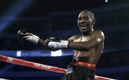 Terence Crawford celebrates his victory against Alejandro Sanabria with a knock down in the sixth round during their NABO lightweight title fight boxing match Saturday, June 15, 2013, in Dallas. (AP Photo/Tony Gutierrez) ORG XMIT: DNA111 [Via MerlinFTP Drop]