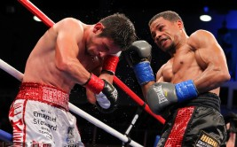 October 27, 2012; Verona, NY, USA;  Mauricio Herrera and Karim Mayfield during their bout on HBO's Boxing After Dark.  Photo: Ed Mulholland/HBO