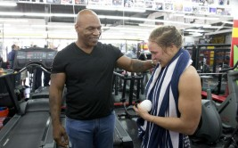 Mixed martial arts fighter Ronda Rousey, right, and former boxer Mike Tyson chat after her workout at Glendale Fighting Club, Wednesday, July 15, 2015, in Glendale, Calif. Rousey, the UFC bantamweight champion, will return to the octagon against Brazil's unbeaten Bethe Correia at UFC 190 in Rio de Janeiro on Aug. 1. (AP Photo/Jae C. Hong)