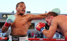 September 28, 2013, Carson, Calif.  ---      Karim Mayfield (L) knocks out Chris Fernandez in the 7th round Saturday at StubHub Center in Carson, Calif.  --- Photo Credit : Chris Farina - Top Rank (no other credit allowed) copyright 2013