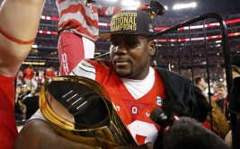 Jan 12, 2015; Arlington, TX, USA;  Ohio State Buckeyes quarterback Cardale Jones (12) holds the national championship trophy after the 2015 CFP National Championship Game against the Oregon Ducks at AT&T Stadium. Mandatory Credit: Matthew Emmons-USA TODAY Sports ORG XMIT: USATSI-179620 ORIG FILE ID:  20150112_jla_se2_234.jpg