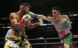 Leo Santa Cruz, right, lands a punch against Abner Mares during the seventh round of their WBC diamond featherweight and WBA featherweight championship boxing bout, Saturday, Aug. 29, 2015, in Los Angeles. (AP Photo/Danny Moloshok) ORG XMIT: LAS121