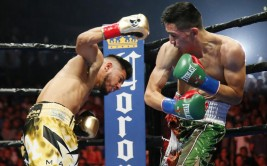 Abner Mares, left, exchanges punches with Leo Santa Cruz, right, during the first round of the WBC diamond featherweight and WBA featherweight championship boxing bout, Saturday, Aug. 29, 2015, in Los Angeles. (AP Photo/Danny Moloshok)