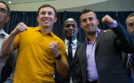 Middleweight boxers Gennady Golovkin, left, of Kazakhstan, and David Lemieux, of Canada,  pose together during a news conference Tuesday, Aug. 18, 2015, in New York, to promote their middleweight world championship title unification bout set for Saturday, Oct. 17, 2015, at Madison Square Garden. At rear center is boxer Bernard Hopkins. (AP Photo/Craig Ruttle) ORG XMIT: NYCR101