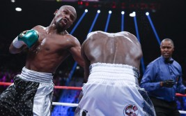 Floyd Mayweather Jr. hits Andre Berto during their welterweight title fight Saturday, Sept. 12, 2015, in Las Vegas. (AP Photo/John Locher)