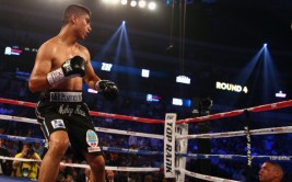 DALLAS, TX - JUNE 15:  (L-R) Mikey Garcia knocks out Juan Manuel Lopez in the fourth round during their Vacant WBO Featherweight Title bout at American Airlines Center on June 15, 2013 in Dallas, Texas.  (Photo by Tom Pennington/Getty Images)