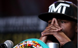 Floyd Mayweather  Andre Berto at a press conference ahead of the upcoming fight at JW Marriott Los Angeles at L.A. LIVE on August 6, 2015 in Los Angeles, California.