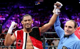 Daniel Jacobs celebrates after defeating Sergio Mora in their WBA Middleweight title fight at the Barclays Center in Brooklyn, on Saturday, August 1, 2015. Jacobs won via TKO in round 2 when Mora could not continue due to an ankle injury.  (AP Photo/Gregory Payan) ORG XMIT: GPNY101